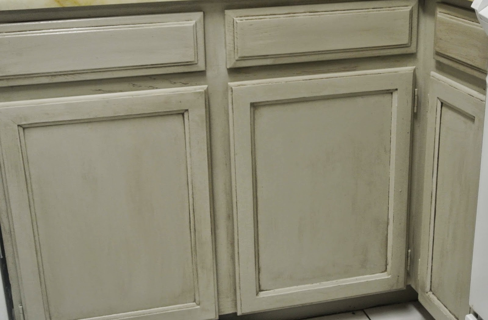 Kitchen cabinet makeover with madame butterfly chalky for Antiquing painted kitchen cabinets